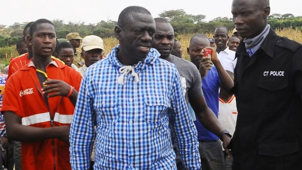 Uganda's opposition leader Kizza Besigye, centre, meets his supporters after casting his vote at a polling station near his country home in Rukungiri, about 700 kilometres west of Kampala, on Thursday. The main opposition candidate in Uganda was arrested Friday for the second time in two days.