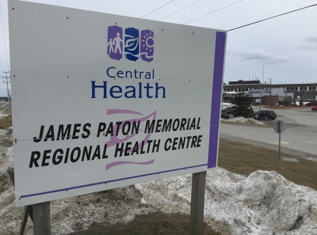 James Paton sign with hospital in background