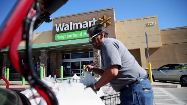 Richard Gutierrez loads groceries after shopping at a Walmart in Dallas.  The U.S. Labour Department said Friday that prices have risen 1.4 per cent over the past 12 months. Consumer prices are now climbing at the fastest annual rate since October 2014.