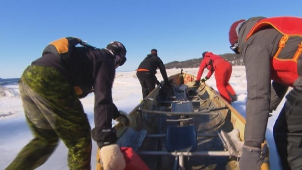 Researchers made use of a snow canoe to get safely across the floes in Ha! Ha! Bay.