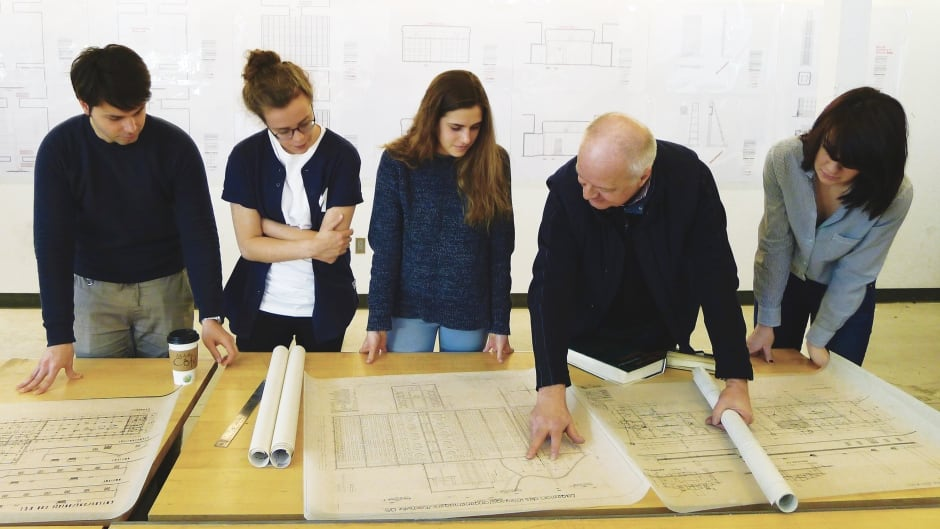 Waterloo Architecture students Alexandru Vilcu, Siobhan Allman, Anna Longrigg, and Piper Bernbaum review the Auschwitz Crematorium evidence plans with Waterloo Architecture Professor and The Evidence Room Co-Principal Robert Jan van Pelt.
