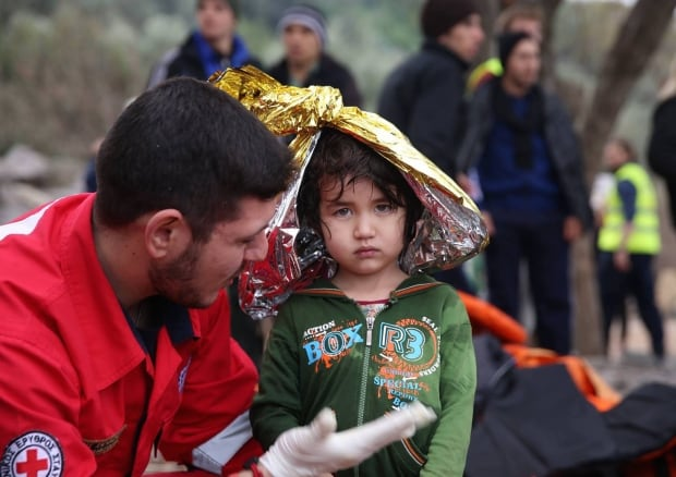 Refugee kid with Red Cross in Lesbos