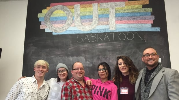 A group of youth and their mentors take a break during a drag workshop offered at Out Saskatoon during the month of February.
