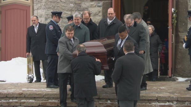 Mourners carry the casket of Bernard Cameron, a local politician and retired English teacher who died last week in a shooting in Almonte, Ont.
