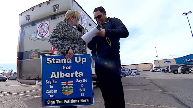A small number of Albertans gathered at the Westbrook Mall Walmart parking lot to protest NDP policies and demand a plebiscite on Friday, Feb. 19, 2016.