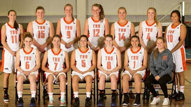 The Thompson Rivers University Wolfpack women's basketball team poses for a team photo. Taysia Worsfold is in the back row, far left.