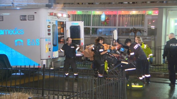 Paramedics tend to a stabbing victim at 71 Thorncliffe Park Dr., in Toronto on Feb. 20 2016.