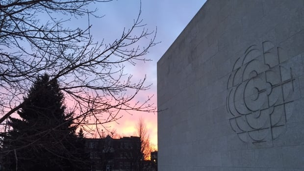 The sun rises on the CBC building in Regina.