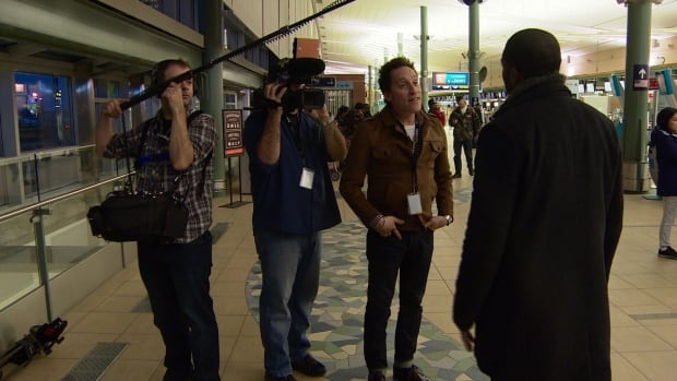 A Toronto film crew shooting a reality TV show at Edmonton International Airport expected a harsh winter, but say warm weather has made them focus on other aspects of the airport's everyday happenings.