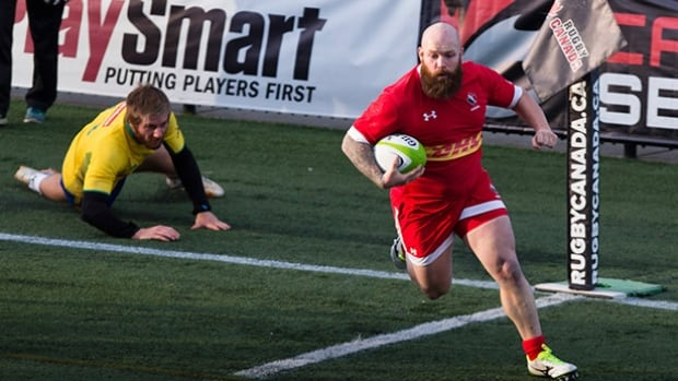 Ray Barkwill escapes the grasp of Brazilian Lucas Muller and scores for Canada at the Americas Rugby Championship at Westhills Stadium in Langford B.C. on Saturday.