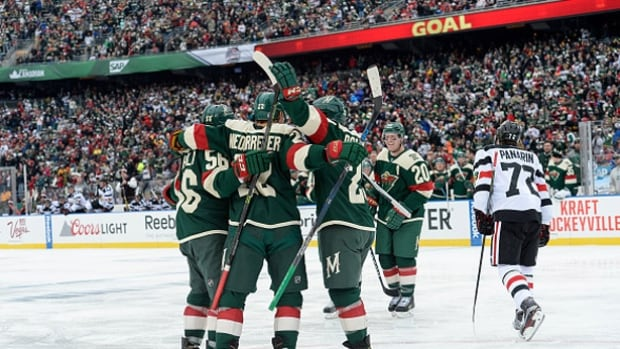 The Minnesota Wild celebrate after scoring in the second period of the 2016 Coors Light Stadium Series game against the Chicago Blackhawks at TCF Bank Stadium in Minneapolis, Minn., Sunday.