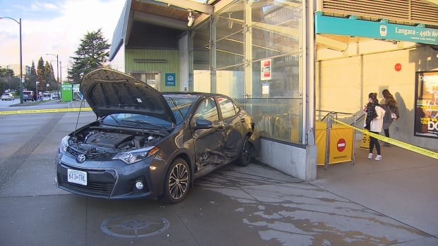 One person was sent to hospital in critical condition after a vehicle collision sent this Toyota into the entrance of the Langara-49th Avenue SkyTrain station.
