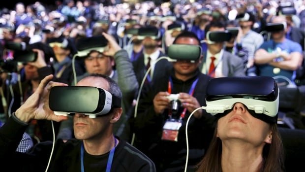 People wear Samsung Gear VR devices as they attend the launching ceremony of the new Samsung S7 and S7 edge smartphones during the Mobile World Congress in Barcelona, Spain, Sunday. Both phones will work with the $100 Gear VR headset that Samsung released last fall.