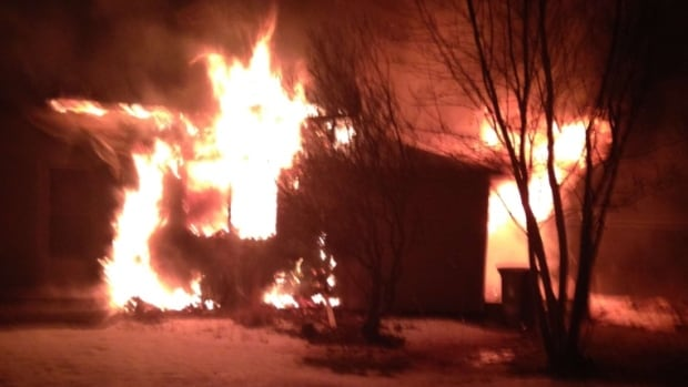 The house was engulfed in flames when firefighters arrived on the scene.