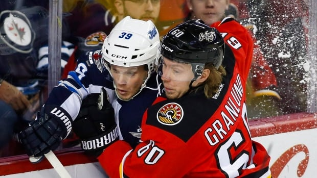 Markus Granlund, right, has been traded by the Calgary Flames to the Vancouver Canucks in exchange for forward Hunter Shinkaruk.