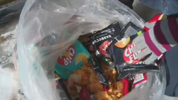 Joanie Champoux says when Dollarama found out she was dumpster diving, it  started opening bags of candies and chips before throwing them in the garbage.