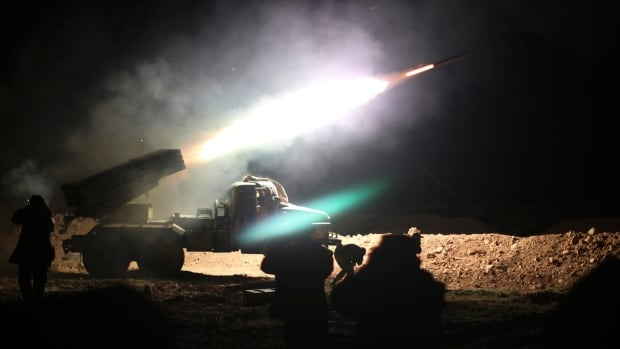 Soldiers from the Syrian army fire a rocket at Islamic State group positions in the province of Raqqa, Syria, in this photo taken Feb. 17, 2016. Syria says it will accept truce planned by the U.S. and Russia, but will continue fighting ISIS and other groups connected to it.