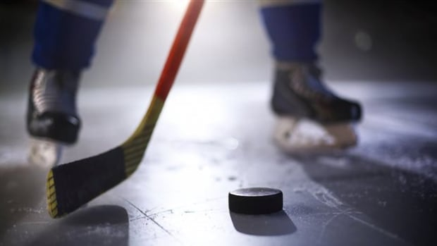 A Quebec Junior AA player was handcuffed on the ice after allegedly spitting on one of the referees.