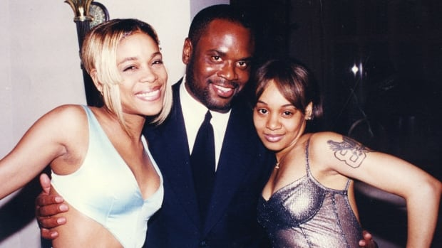 """L.A. Reid is flanked by Tionne """"T-Boz"""" Watkins and Lisa """"Left Eye"""" Lopes of TLC."""