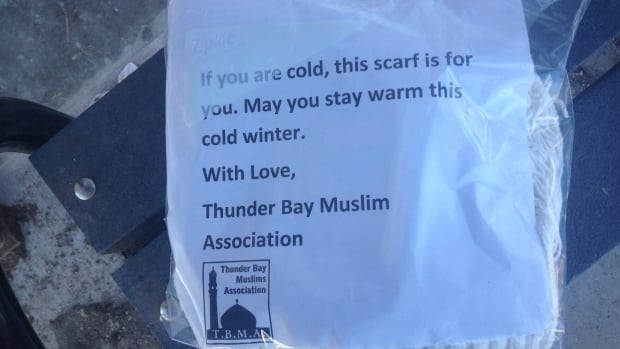 A note tucked inside the bag invites anyone in need to help themselves to the scarf.