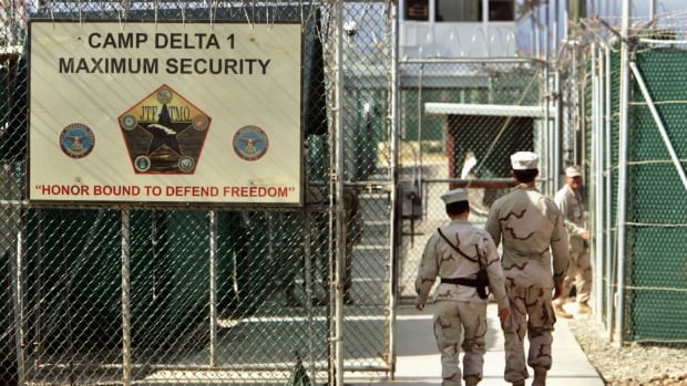 U.S. military guards walk within Camp Delta military-run prison at the Guantanamo Bay U.S. Naval Base in Cuba.