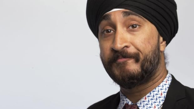 "Jasmeet Singh wears a turban as a part of his Sikh faith. ""It is not a hat,"" he said."