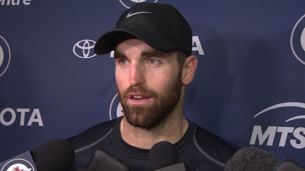 Winnipeg Jets forward and captain Andrew Ladd speaks to reporters after a team practice in Winnipeg on Tuesday.
