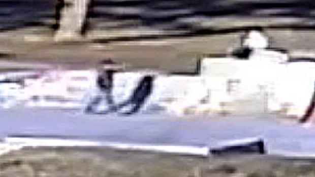 A close-up of the surveillance video shows a man pointing what appears to be a gun at a person at a skate park in Williams Lake, B.C.
