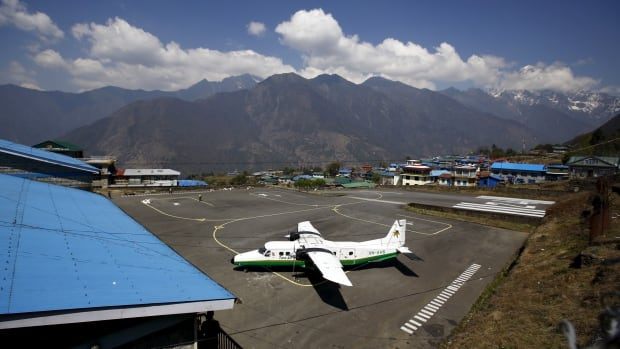 A Twin Otter aircraft belonging to Tara Air is pictured at Tenzing Hillary Airport, in Lukla, approximately 2800 meters above sea level, in Solukhumbu district, Nepal, in this April 2014 file photo. The plane pictured here is not the plane that was involved in Wednesday's crash.