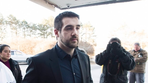Marco Muzzo, right, arrives with family members for his sentencing hearing in Newmarket, Ont., on Tuesday, February 23, 2016.