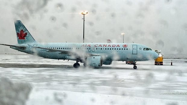 Today's mix of rain, snow and freezing rain have caused flight delays at Toronto's Pearson airport. Air Canada is allowing passengers on affected flights to rebook without penalty, space permitting.