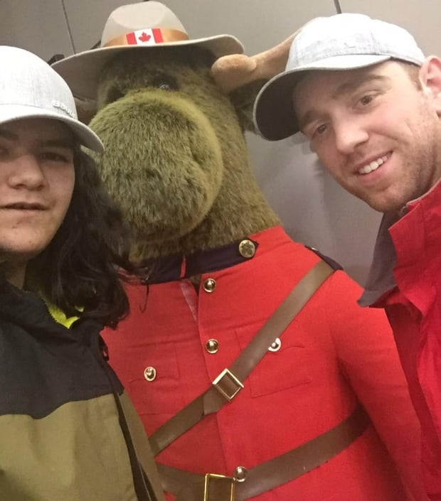 Cyrus Nuna, RCMP Cst. Dan Sharpe, and a Mountie moose