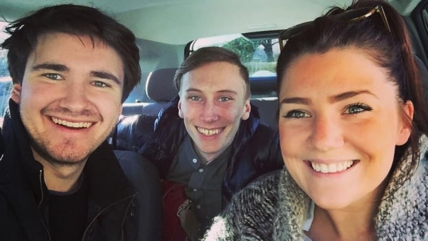 Two creators of the Spare Ride app, Josh Andrews (left), and Kristoffer Vik Hansen (middle), carpool with driver Becca Koole Tuesday morning, one day after the app launched in Vancouver.
