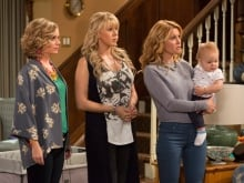 Andrea Barber, Jodie Sweetin, and Candace Cameron-Bure are shown during a scene from Fuller House. The entire 13-episode season hits Netflix on Friday.