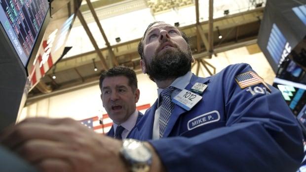 Traders work on the floor of the New York Stock Exchange on Feb. 24, 2016.