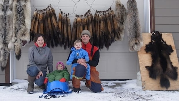 Andy and Lisa Preto of Haines Junction, with furs they trapped last year. The couple works two traplines - one near Haines Junction, and another near Mayo.