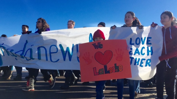 La Loche stands together as the community takes part in the Reclaiming Our School Walk.