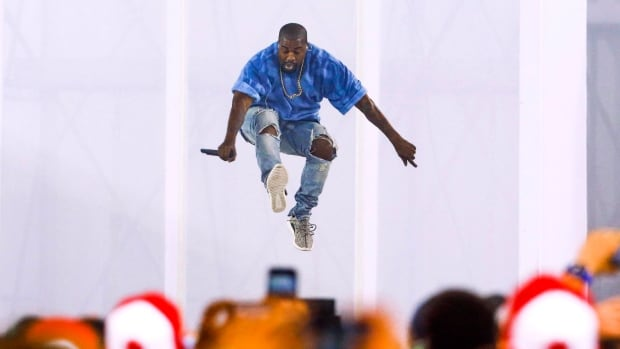 Kanye West performs during the closing ceremony of the 2015 Pan Am Games in Toronto. The rapper took to Twitter Tuesday to respond to criticism of his work by the legendary rock producer Bob Ezrin. (Mark Blinch/Canadian Press)