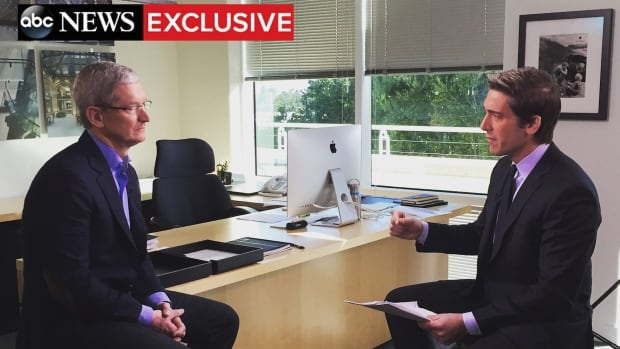 Apple CEO Tim Cook, left, appears during an interview with ABC News anchor David Muir on Wednesday. He says unlocking an iPhone for the FBI could 'expose people to incredible vulnerabilities.'