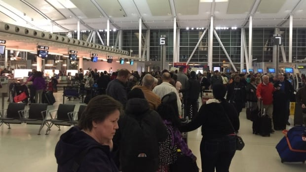 Pearson airport's Terminal 1 was crowded Thursday morning after a partial power outage shut down self check-in computers.