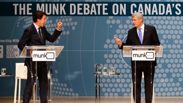 Justin Trudeau and Stephen Harper exchange words during an election debate in 2015.