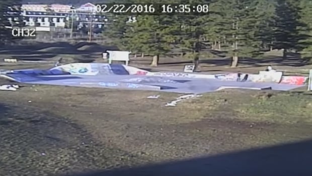 Surveillance video shows a man, in the right side of the skate park bowl, pointing what appears to be a gun at a person in Williams Lake, B.C.