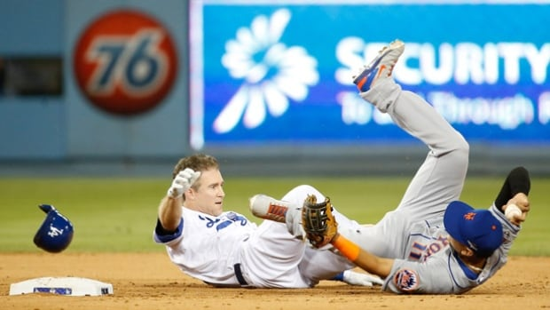 Chase Utley's hard slide into Ruben Tejada, right, that broke Tejada's leg in the NL division series last October, was the impetus for MLB's rules changes regarding sliding into bases.