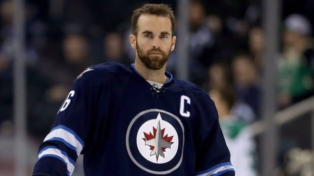Andrew Ladd warms up as the Winnipeg Jets prepare to play the Dallas Stars on Tuesday, two days before the team traded Ladd to the Chicago Blackhawks.