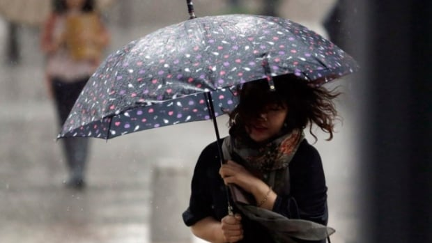 New Brunswickers will have to hold on to their umbrellas today with gusty winds expected to continue along with scattered showers and flurries before the unsettled weather clears for a sunny Saturday.