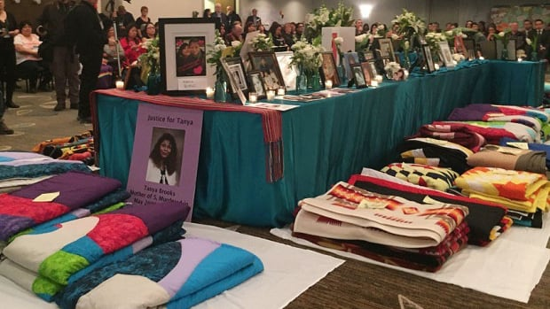 A memorial sits in the centre of a room hosting the national roundtable on missing and murdered indigenous women in Winnipeg.