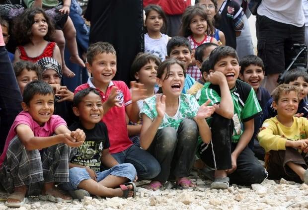 Mideast Lebanon Syria Clown Therapy