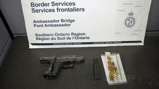 The Canada Border Services Agency on Friday released this photo of a handgun dropped at the Ambassador Bridge in January.