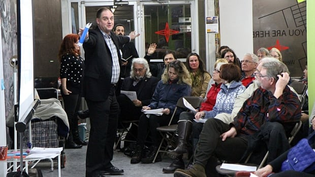 Paul Johnson, the city's former director of neighbourhood initiatives and new head of LRT, talks to the crowd at a west harbour consultation meeting on Thursday. Much of the meet was spent discussing a plan to sell two North End social housing properties to build more units around the west harbour.