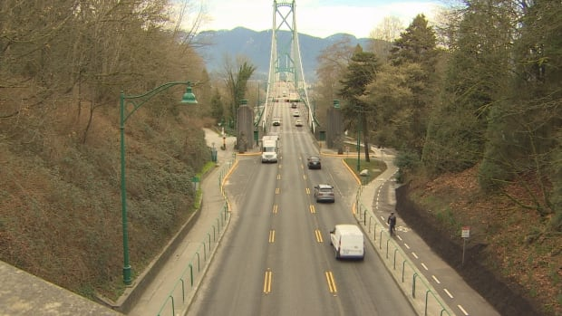 The new bike lanes include wider paths and safety fences on both sides of the Stanley Park Causeway.